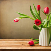 Beautiful tulips bouquet on wooden table — Stock Photo
