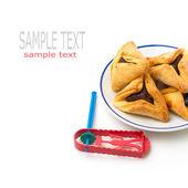 Hamantaschen cookies and grogger — Stock Photo