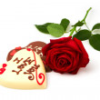 Valentine's Day concept. Heart shape chocolate and red rose on white background — Stock Photo
