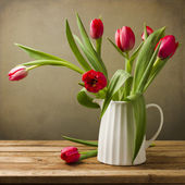 Still life with tulips bouquet on wooden table — Stock Photo