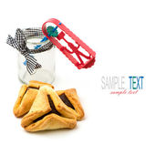 Hamantaschen cookies and grogger forJewish festival of Purim — Stock Photo