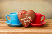 Coffee cups and heart shape chocolate for Valentine's Day — Stockfoto