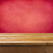 Background with wooden table and pink grunge wall — Stock Photo