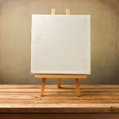 Background with blank canvas on wooden table — Stock Photo