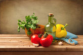 Fresh healthy vegetables on wooden table — Stock Photo