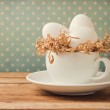 Retro still life with eggs and coffee cup — Stock Photo #19971809