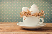 Retro still life with eggs and coffee cup — Stock Photo