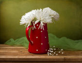 Still life with chrysanthemum flowers in red jug — Stock Photo