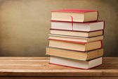 Bunch of vintage books on wooden table — Stock Photo
