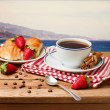Beautiful breakfast arrangement on wooden table — Stock Photo
