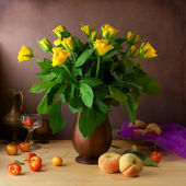 Classical still life with yellow roses and fruits — Stock Photo