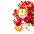 Christmas holiday still life with gift boxes and wine glass - Stock Photo