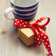 Warm cup of tea with cookies on wooden tabletop — Stock Photo