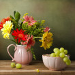 Stock Photo: Still life with beautiful flower bouquet and green grapes