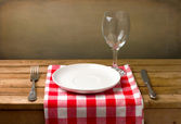 Wooden table setting over grunge background — Stock Photo