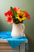 Beautiful gerbera flower bouquet on white table — Stock Photo