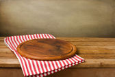 Wooden board stand on tablecloth — Stock Photo