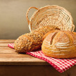 Fresh bread on wooden vintage table — Stock Photo