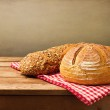 Fresh bread on tablecloth — Stock Photo #22243637