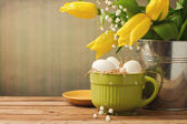 Easter decorations on wooden table — Stock Photo