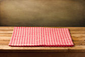 Empty table with tablecloth over grunge background — Foto de Stock