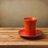 Retro cup of tea on wooden table — Stock Photo