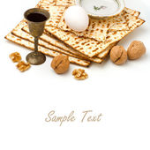 Matzo, egg, walnuts and wine for passover celebration — Stock Photo