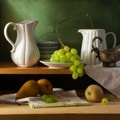 Still life on kitchen shelf over grunge background — Stock Photo