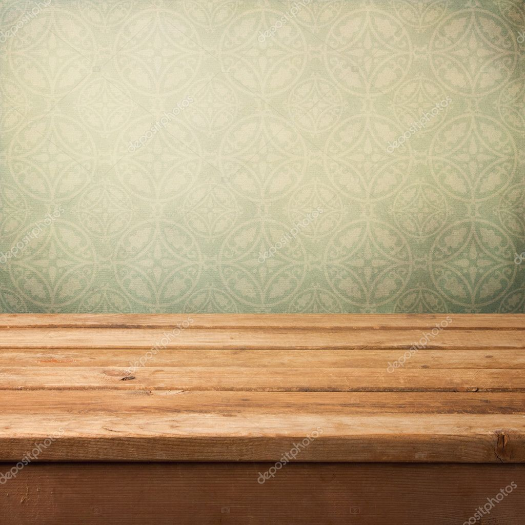 vintage wooden deck table over grunge wallpaper with