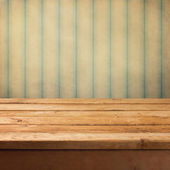 Wooden deck table over grunge vintage background — Stock Photo
