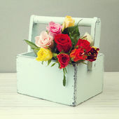 Rose flowers in wooden box — Stock Photo