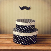 Gift polka dots boxes wirh mustache decoration — Stock Photo