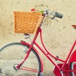 Vintage bicycle with basket over concrete wall — Stock Photo #24033291