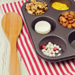 Stock Photo: Cupcake ingredients in oven tray over red striped tablecloth