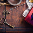 Vintage retro background with key and book — Stock Photo #24035939
