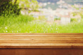 Empty wooden table over bokeh natural background — ストック写真