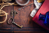 Vintage retro background with key and book — Stock Photo