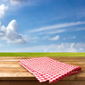 Empty table with tablecloth — Stock Photo
