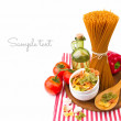 Italian pasta with vegetables on striped tablecloth — Stock Photo