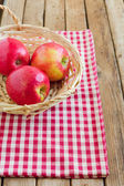 Red apples in basket on tablecloth — 图库照片