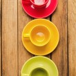Colorful coffee cups and plates — Stock Photo