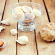 Seashells over wooden background - Stock Photo