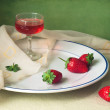 Still life with strawberry and glass of wine — Stock Photo
