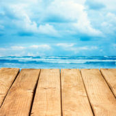 Empty wooden deck over sea and sky background — Stock Photo