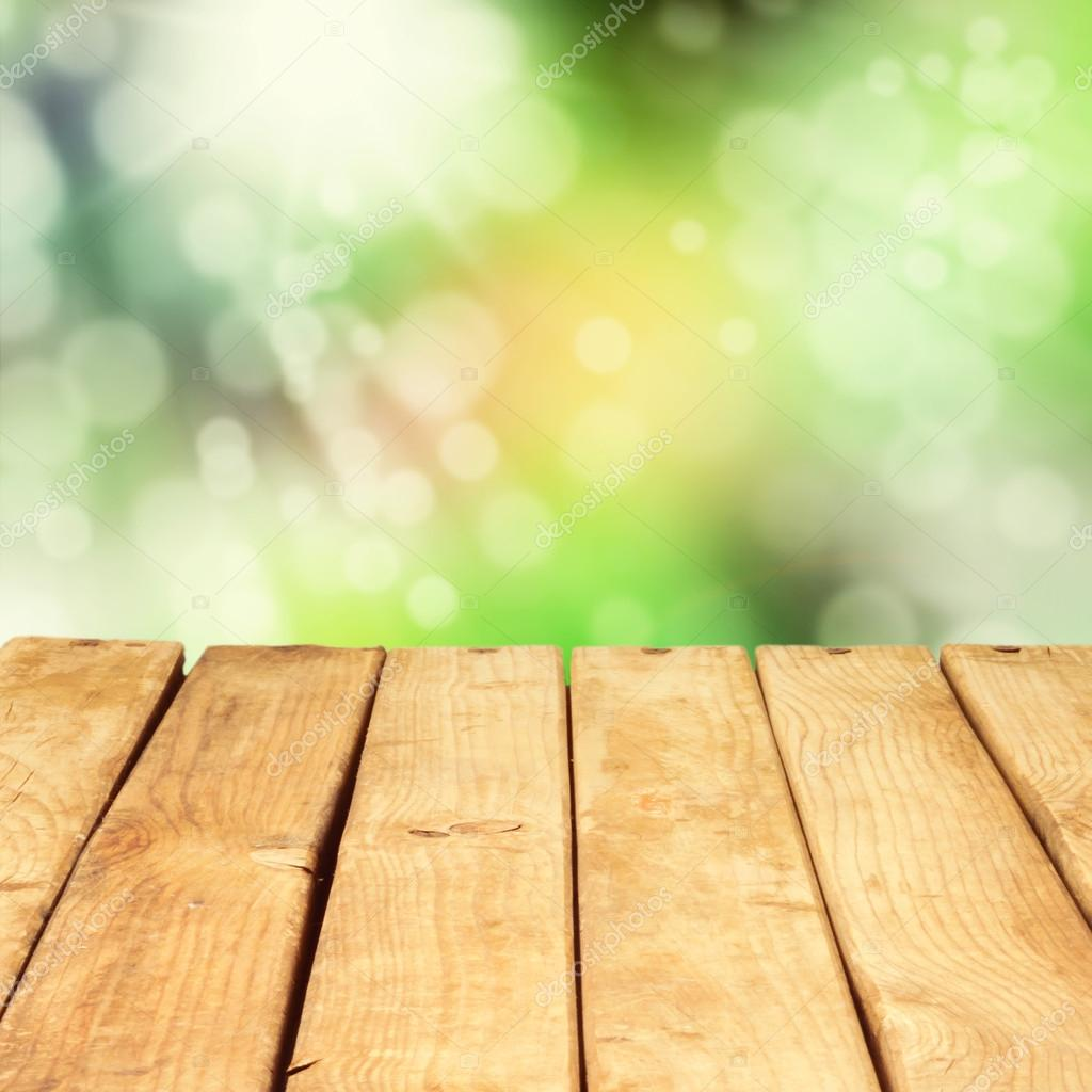 Wooden deck table over beautiful bokeh background stock for Table background