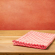 Empty wooden table with checked tablecloth — Stock Photo #26616917