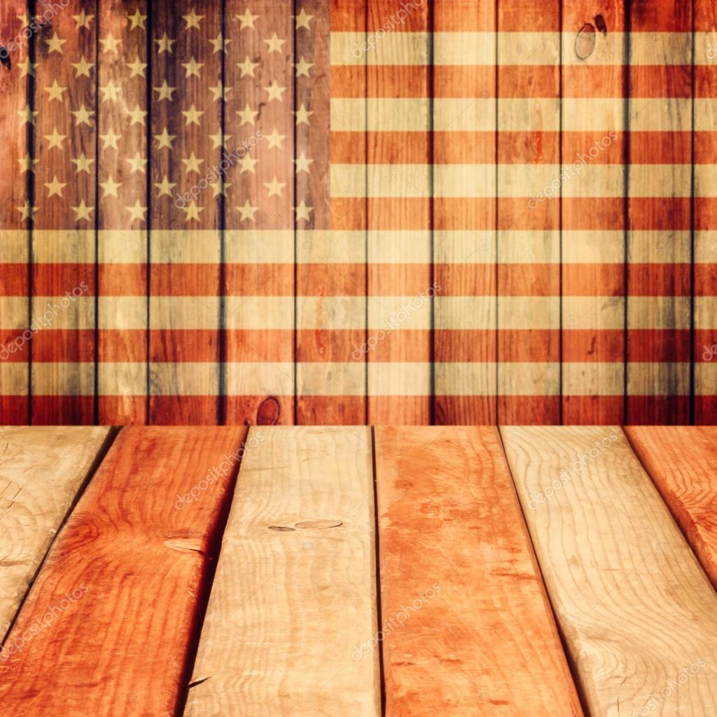 Empty wooden deck table over usa flag background stock photo