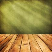 Wooden deck floor over green grunge background. — Stock Photo