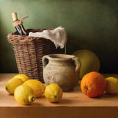 Still life with lemons and oranges — Stock Photo