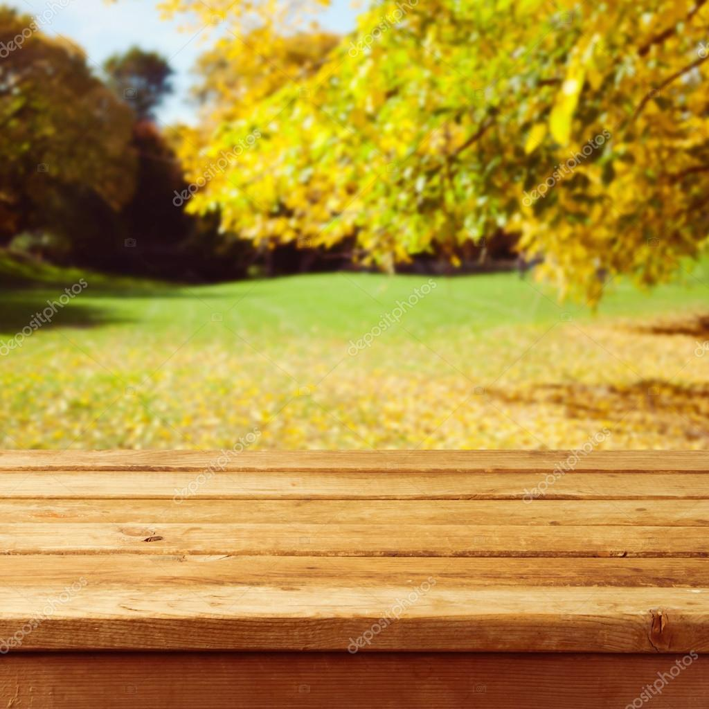 Empty Wooden Table Over Autumn Park Background Ready For